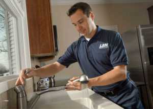 Len the Plumber in PA home fixing a faucet