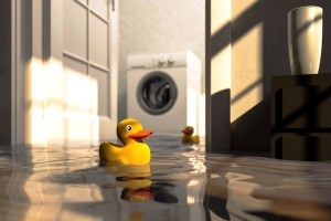 Rubber duckies floating on standing water in a flooded basement laundry room.
