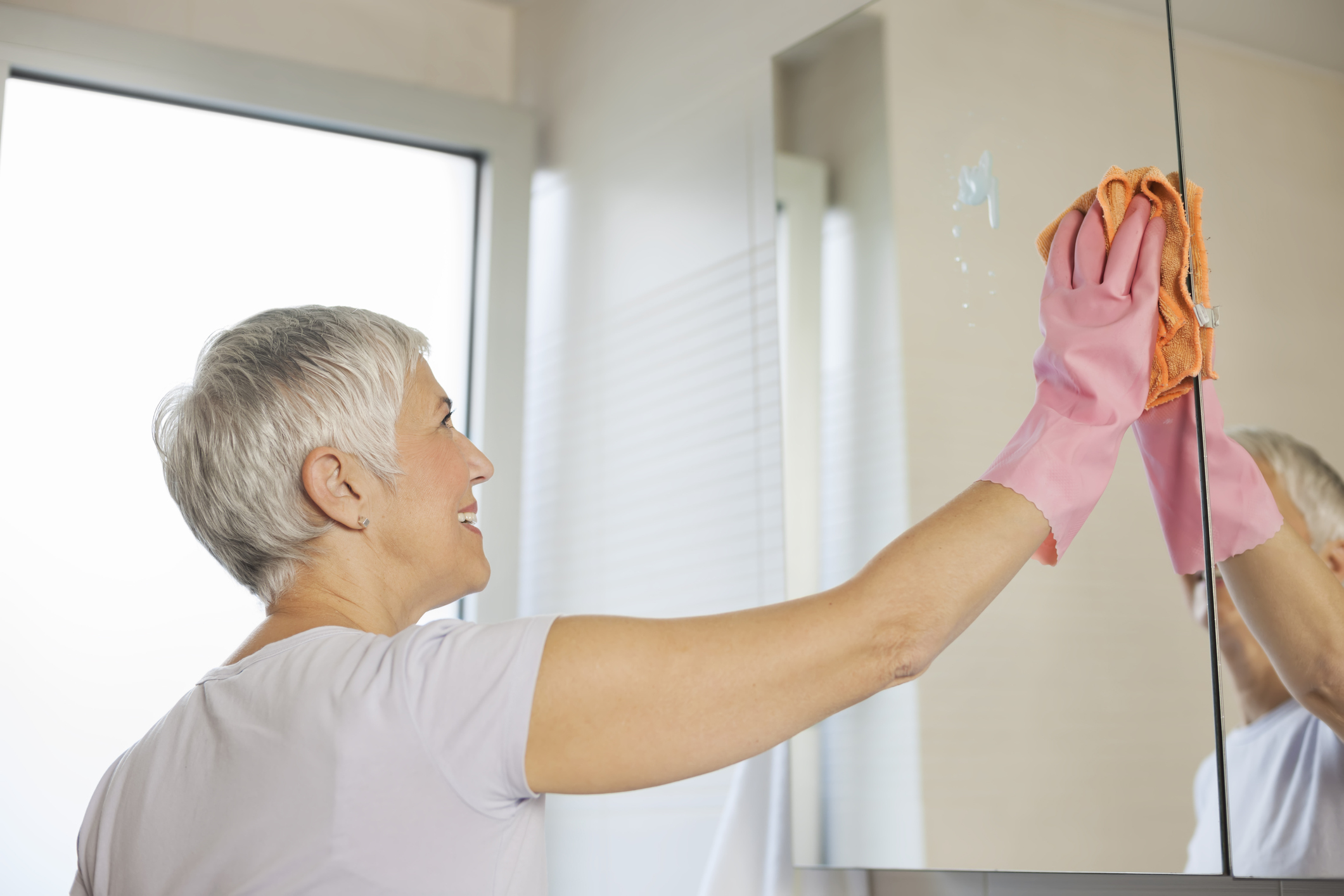 Mature Woman Cleaning Home Len The Plumber