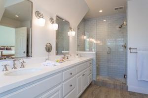 Jack and Jill white sink in fresh, clean bathroom.