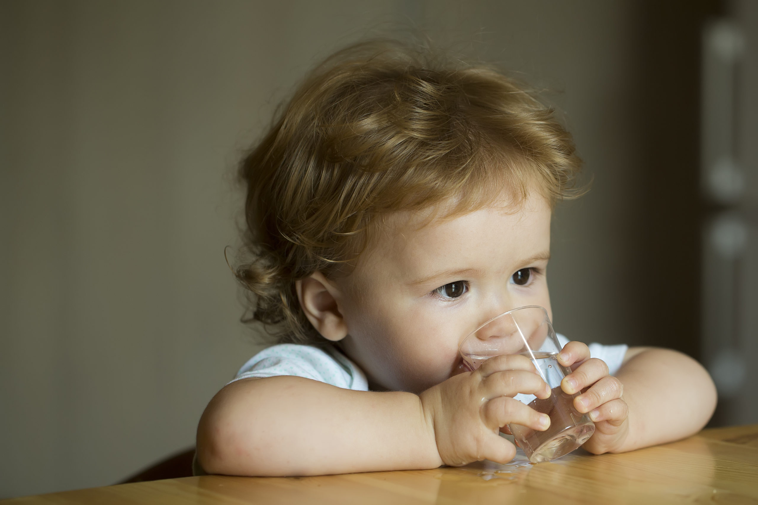 infant drinking glass of water